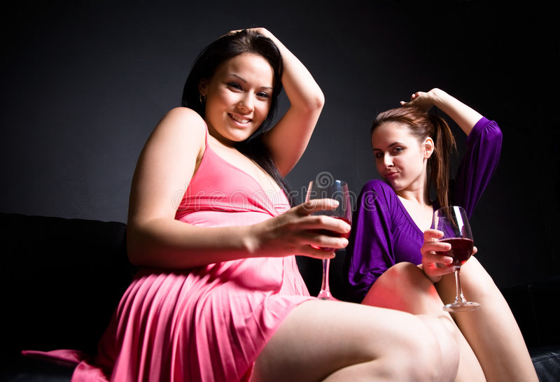 Beautiful women drinking and dancing royalty free stock photos