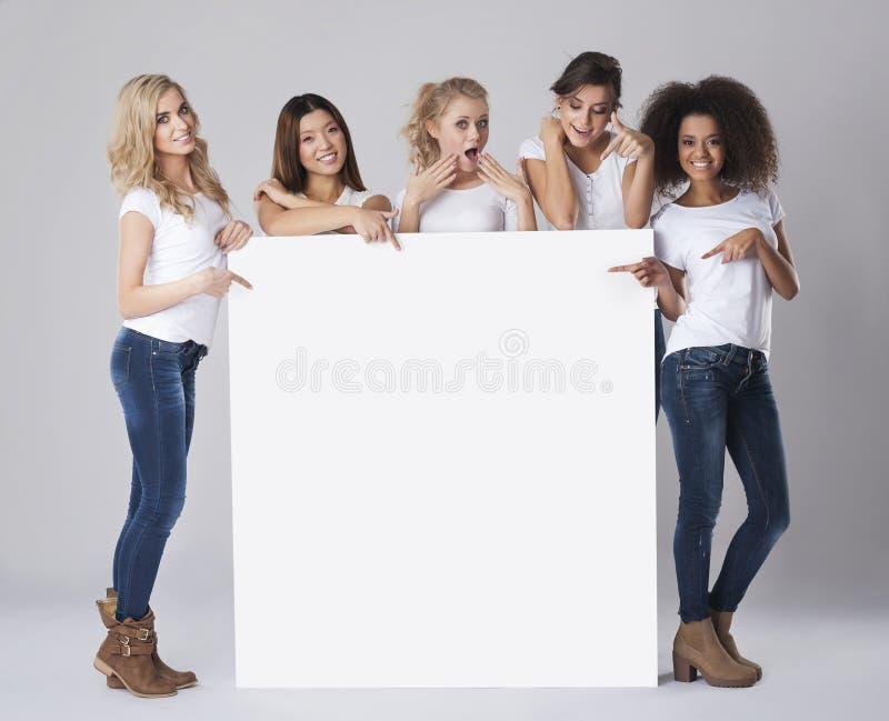 Beautiful women with empty board stock photos
