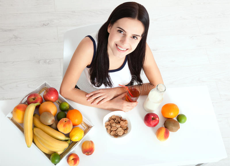 Beautiful women exists with pure skin on her face sitting at a table and eat breakfast. Asian woman eating healthy food at. Beautiful woman exists with pure skin stock photography