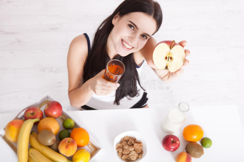 Beautiful women exists with pure skin on her face sitting at a table and eat breakfast. Asian woman eating healthy food at. Beautiful woman exists with pure skin royalty free stock images
