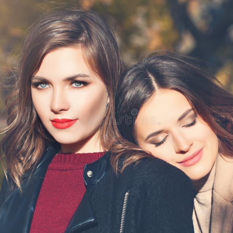 Beautiful women faces closeup portrait, girls outdoor stock images