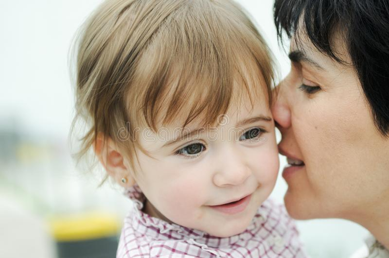 Woman and her cute little daughter are hugging stock photos