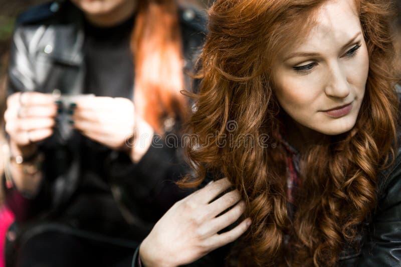 Woman looking away. Beautiful women looking away and touching her hair stock photos