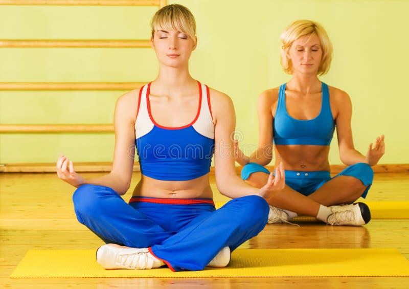 Beautiful women meditating royalty free stock photos
