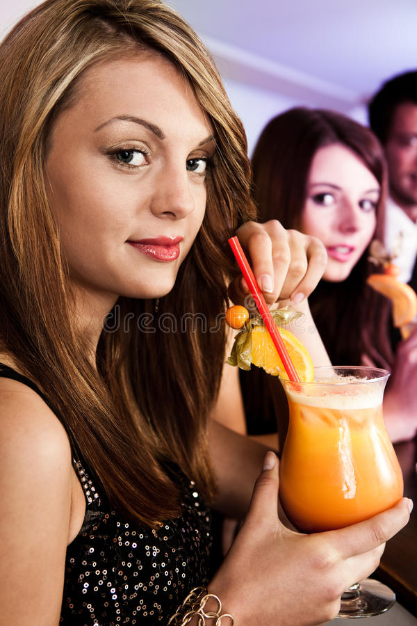 Beautiful women in nightclub stock photos