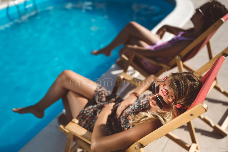 Women relaxing and sunbathing in summer stock image