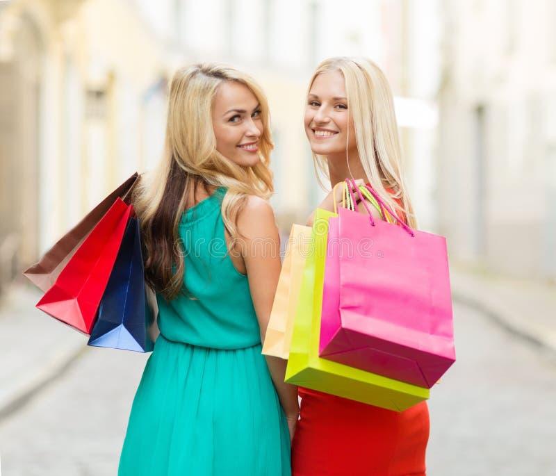 Beautiful women with shopping bags in the ctiy stock photos