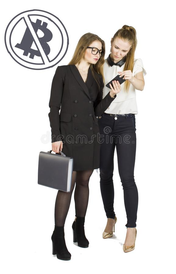 Beautiful women standing over white background with bitcoin sketches and talking. Virtual money concept. Cryptocurrency stock photos