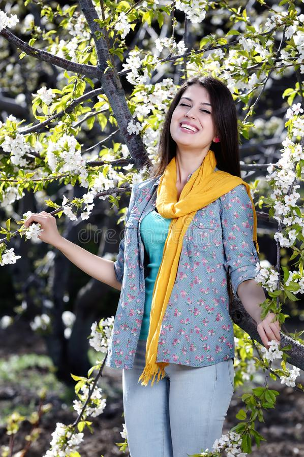 Beautiful Woman In Spring Garden Stock Photo - Image of