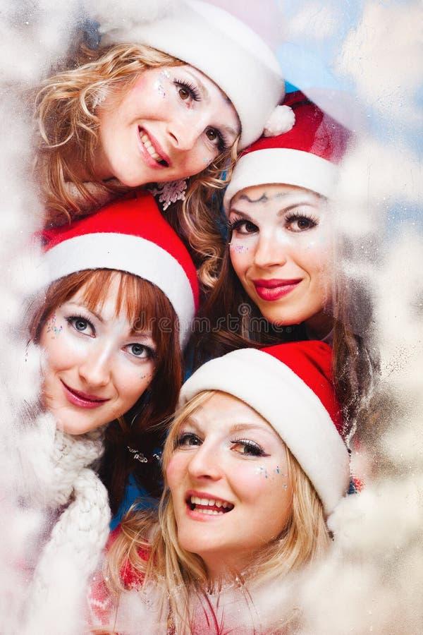 Beautiful Women Wearing A Santa Hat Royalty Free Stock Images