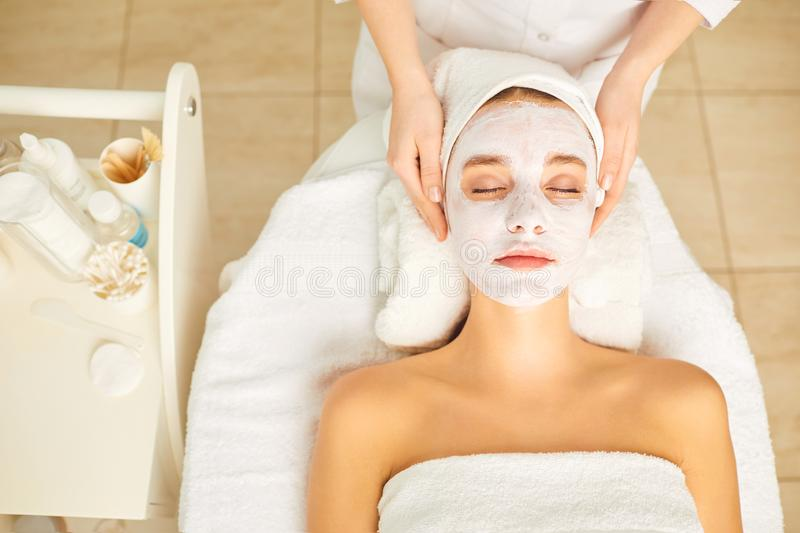 Woman in cosmetic mask lying down in the beauty salon. royalty free stock photography