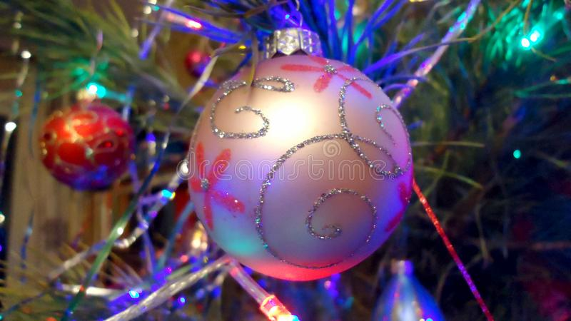 Beautiful wonderful new year holiday ball hanging on a xmas tree. Macro royalty free stock images