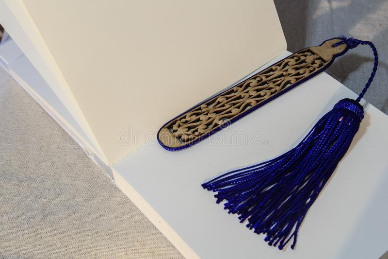 Beautiful bookmark on a sketch book. Beautiful wood bookmark on a sketch book closeup view stock photo
