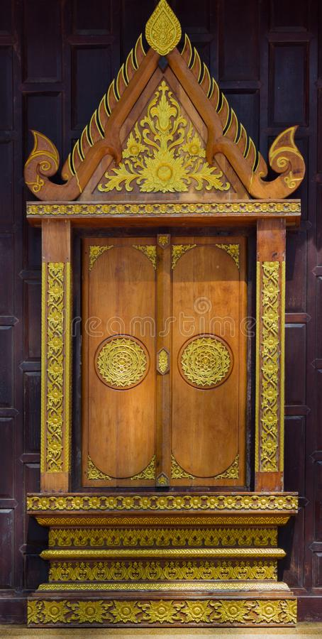 Wood carving depicting on Window chapel thai temple royalty free stock photography
