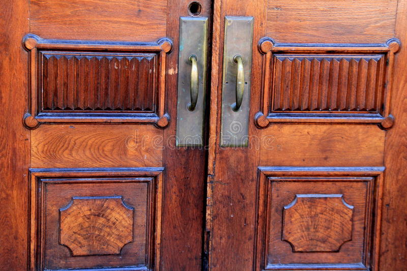Beautiful wood grain and craftsmanship detail of doors stock photography