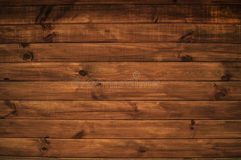 A background with a beautiful structure of horizontal wooden boards of brown color royalty free stock photos