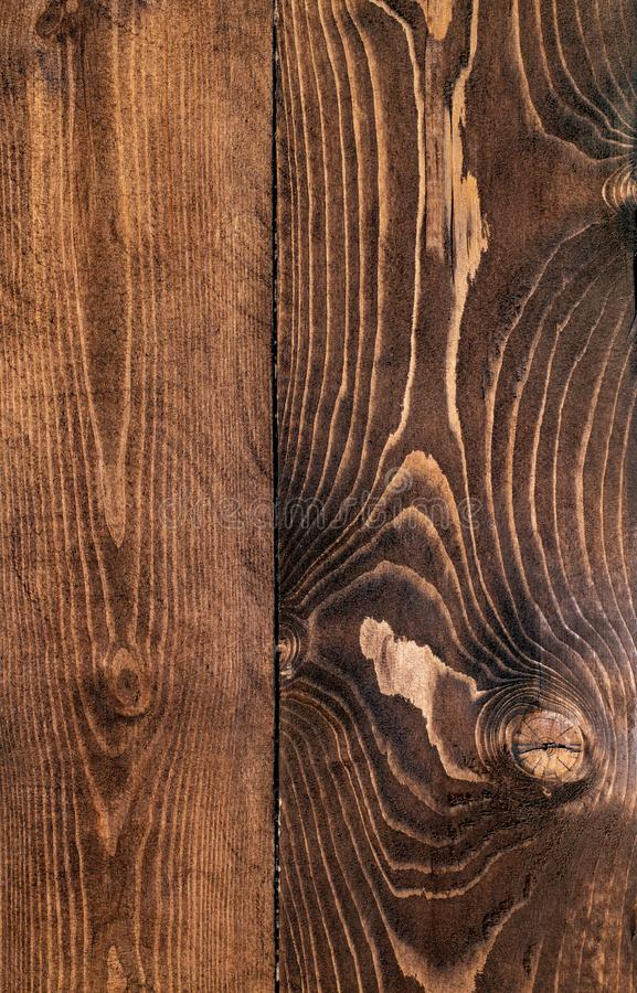 Beautiful wooden boards texture. Dark brown wood texture. Boards, tinted stain walnut. Beautiful wooden boards texture stock photo