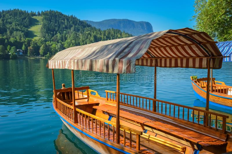Beautiful wooden boat on famous Bled Lake in Slovenia. Bled Lake, known for its castle and island, is popular travel destination. royalty free stock photo