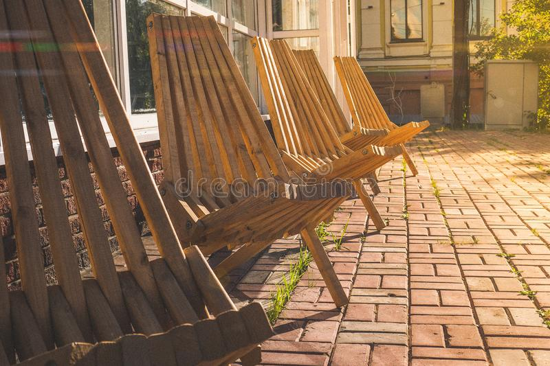 Beautiful wooden chairs on the street stock photo