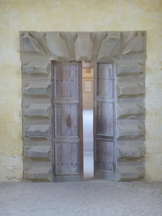 Beautiful Wooden Doors with a Stone Surround royalty free stock photography