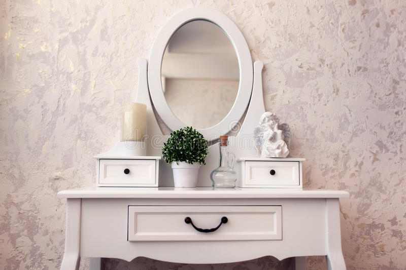 Beautiful wooden dressing table with mirror on white background wallpaper.  royalty free stock image