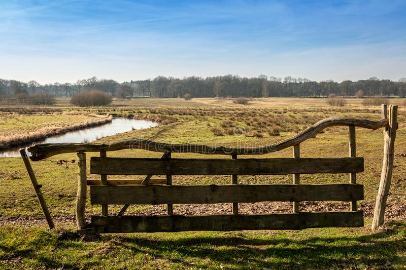 A beautiful wooden fence in the Netherlands province Drenthe. A beautiful wooden fence nearby the brook in the Netherlands province Drenthe, in the nature royalty free stock photos