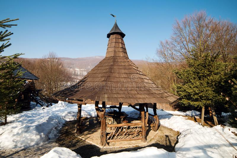 Beautiful wooden gazebo for relaxation in winter time. Mountain landscape. Christmas vacation. Traditional resort in carpatian royalty free stock images