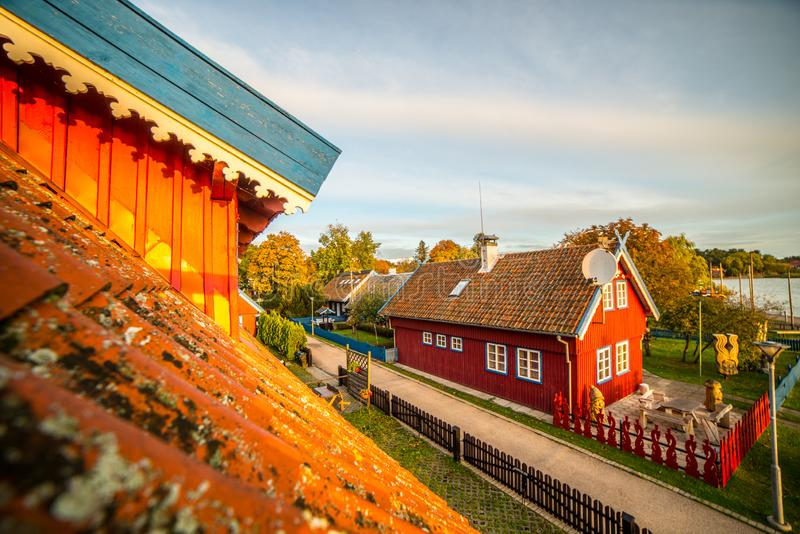 Wooden houses at sunset light. Beautiful Wooden houses in a city Nida, Lithuania, fal time royalty free stock image