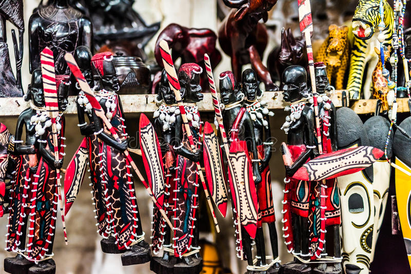 Beautiful wooden painted figures Masai at Zanzibar market stock photos