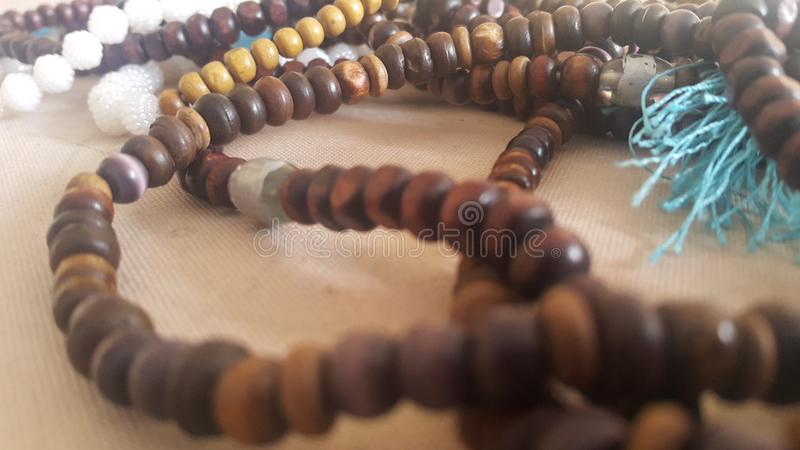 Beautiful wooden prayer beads or rosary placed over fabric background. Religion concept of ramadan or Eid for muslims religious faith necklace jewelry  islam stock image