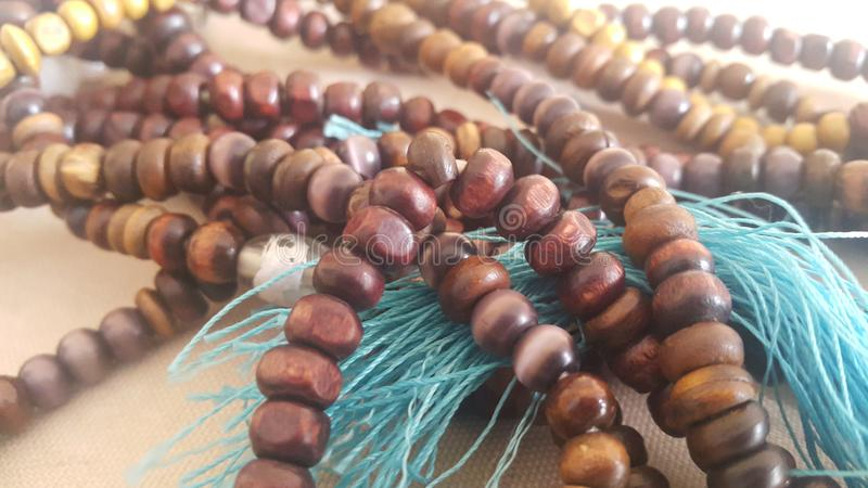 Beautiful wooden prayer beads or rosary placed over fabric background. Religion concept of ramadan or Eid for muslims religious faith necklace jewelry isolated royalty free stock photos