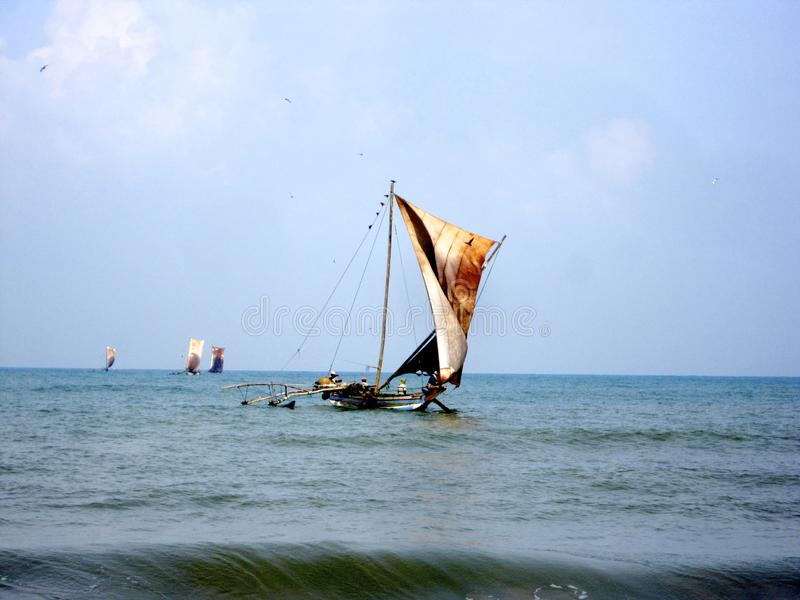 Beautiful wooden ship with leather sails on mast fluttering in wind royalty free stock images
