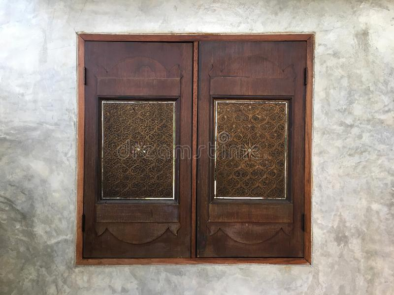 Beautiful wooden window texture background on cement wall. royalty free stock photos