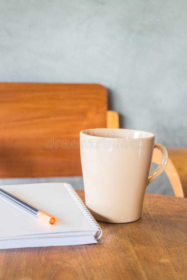 Beautiful wooden work table with cup of coffee. Stock photo stock image