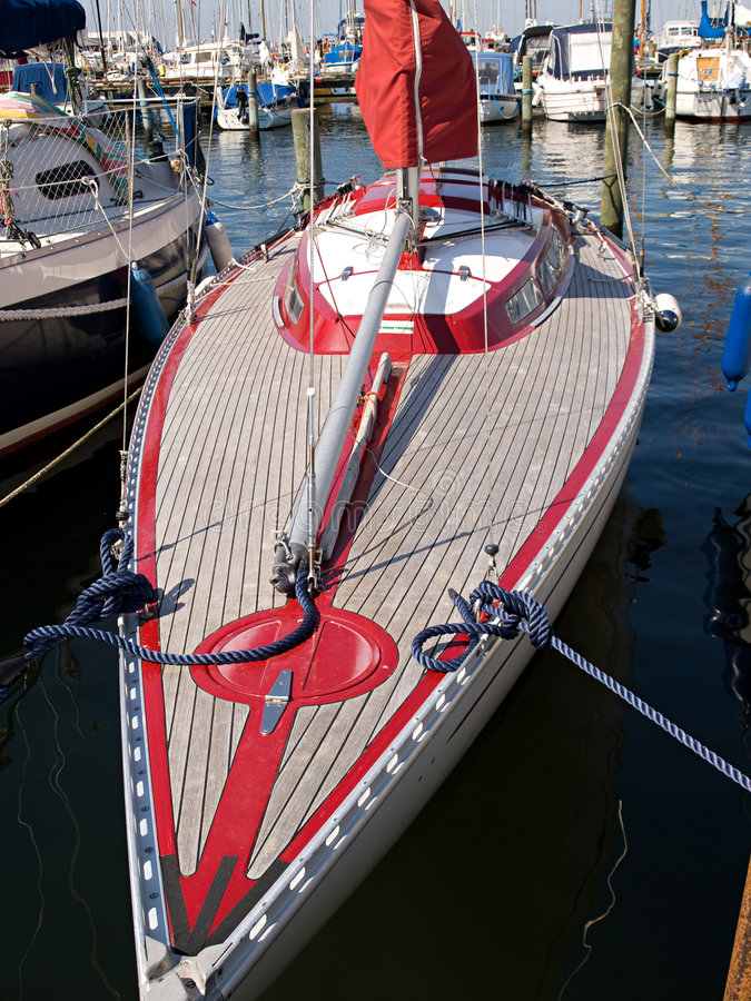 Beautiful wooden yacht. Beautiful modern design wooden yacht in a marina stock photography
