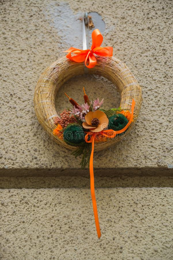 Beautiful wreath of flowers hanging on the wall. Budapest, Hungary stock images