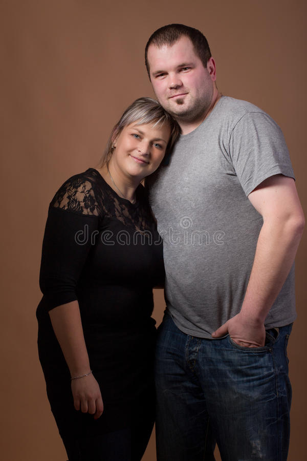 Beautiful xxl woman with her husband royalty free stock photo