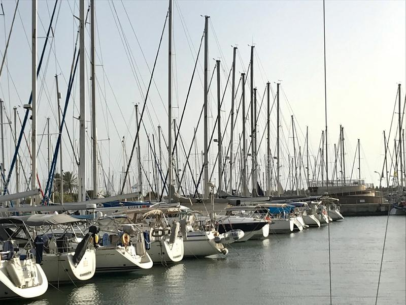 Beautiful yacht ship moored at port with other boats on blue salted sea royalty free stock photography