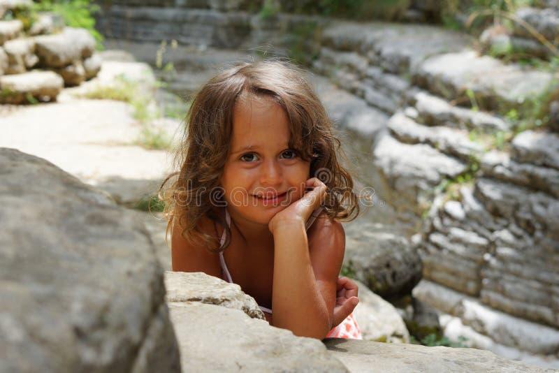 Beautiful 4 year old girl in the beautiful scenery of Papingo Rock Pools stock photo
