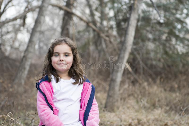 Beautiful 5-year Old Girl Outside on a Fall Day. With Dried Flowers and Sunlight royalty free stock photos