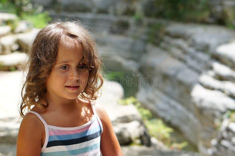 Beautiful 4 year old girl in the beautiful scenery ofPapingo Rock Pools royalty free stock photo