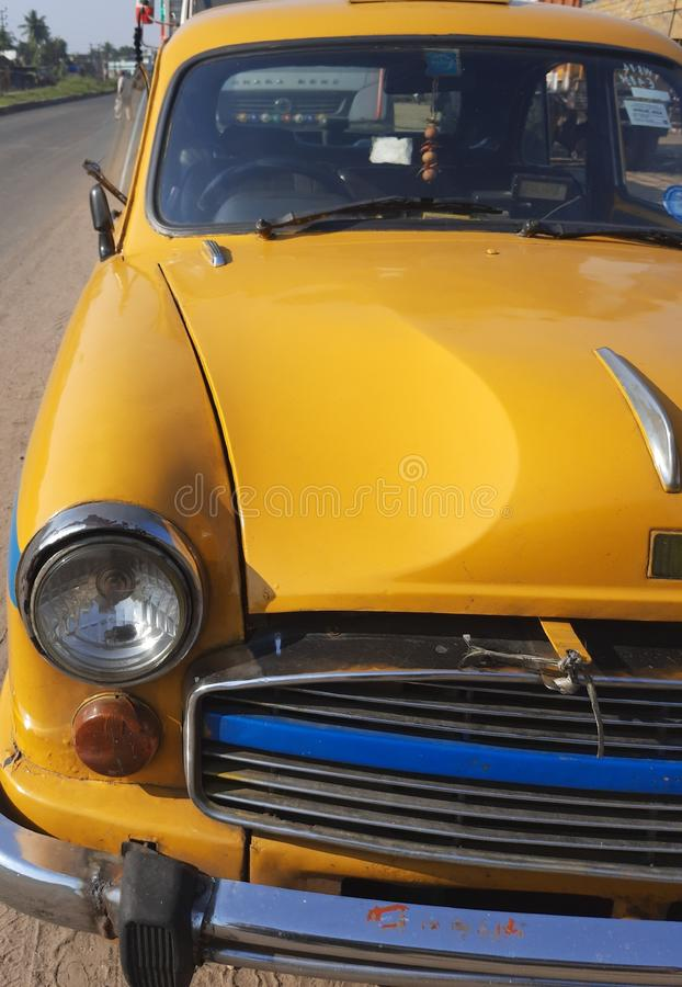 Beautiful yellow car with their head lights looking cool ambassador stock image