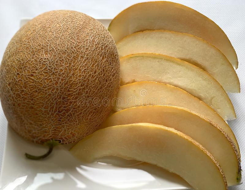 Beautiful yellow melon. Sweet yellow fruit, melon slices. Dietetic food. Natural vitamins stock photo