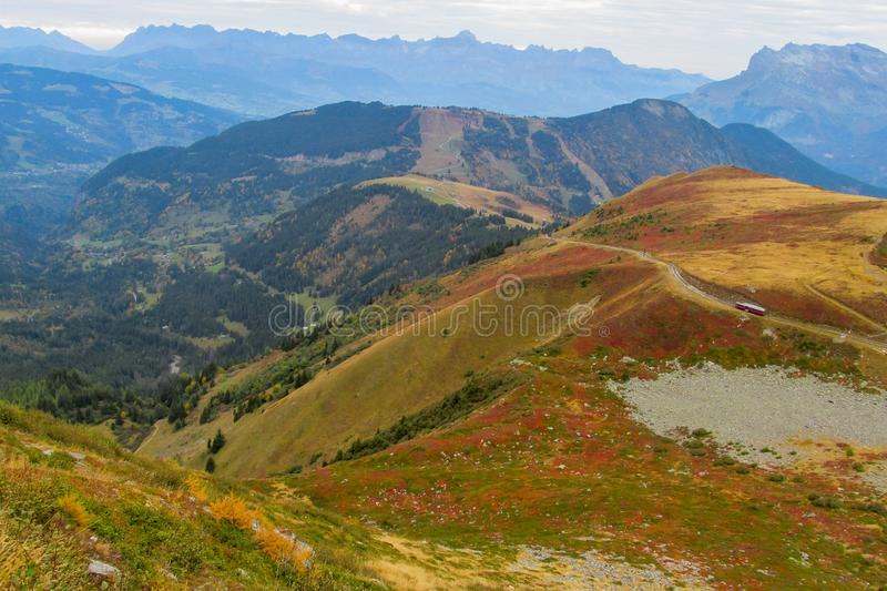 Yellow and red colors of autumn in the mountain valley. Beautiful yellow and red colors of autumn in the mountain or hill valley stock photography