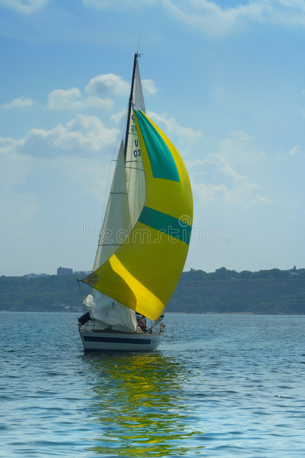 Free Beautiful Yellow Sail In The Light-blue Sky Royalty Free Stock Images - 1009489