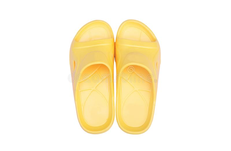 Beautiful yellow sandal isolated on a white background with Include clipping path. A Beautiful yellow sandal isolated on a white background with Include clipping stock images