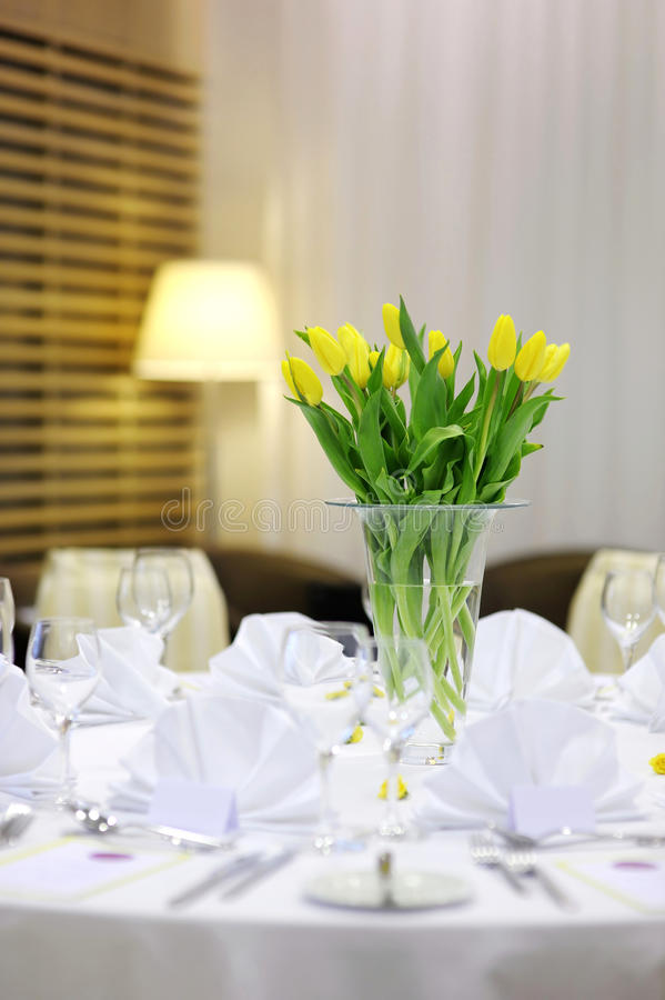 Beautiful yellow tulips on a festive table stock photography
