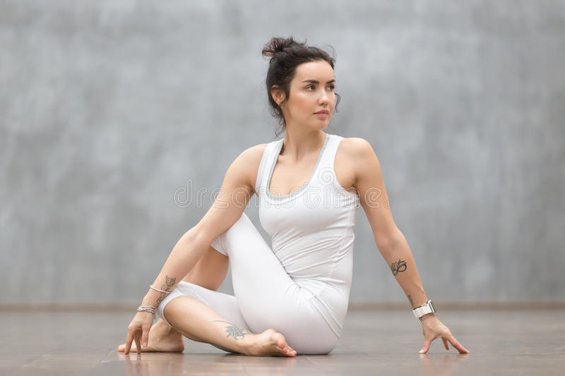 Beautiful Yoga: Matsyendrasana Pose royalty free stock photography