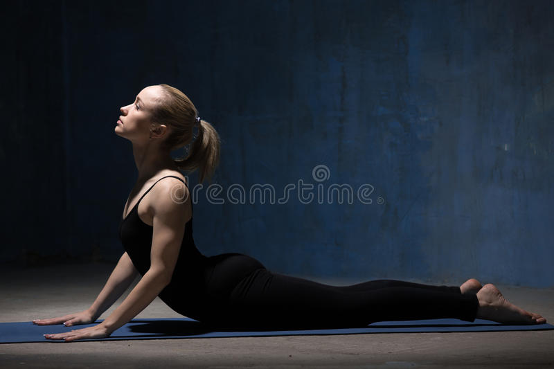 Beautiful Yoga Woman Doing Cobra Pose stock photography