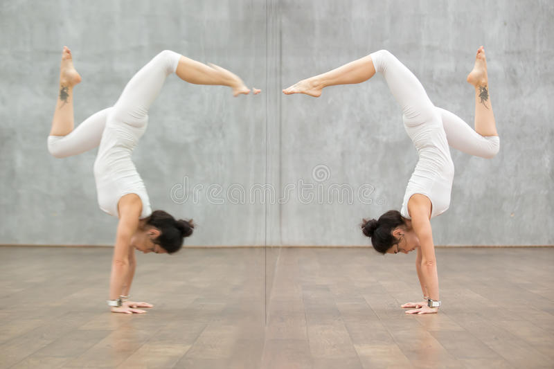 Beautiful Yoga: woman in handstand pose stock photography